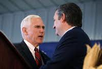 Republican vice presidential candidate Mike Pence appeared with Sen. Ted Cruz, R-Texas, during a campaign rally Thursday in Prole, Iowa. (Charlie Neibergall/The Associated Press)