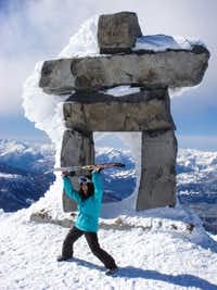 A snowboarder poses in front of the Inuksuk at British Columbia's Whistler Blackcomb Resort. Vail and Whistler have announced plans to merge, and although few things will change this season, if all goes well, Whistler may be on the Epic Pass next season.(Dianne Leeth,Special Contributor)