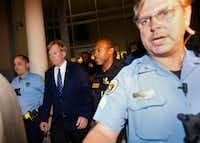 Former Klansman and current U.S. Senate candidate David Duke is hastily escorted to a police car, as protesters in the area teach for his exit, after a debate for Louisiana candidates for the U.S. Senate, at Dillard University in New Orleans.(Gerald Herbert/AP Photo)