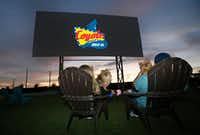 <p>Tina and Art Lira of Lewisville and their dogs Amador and Lola settle in at the Coyote Drive-In in Lewisville. (Louis DeLuca/Staff Photographer)</p><p><br></p><p></p>