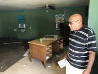 Pervez Raza, owner of the home at 2401 Penn St. in Irving, oversees cleanup of a grupo after seven men were arrested Oct. 4 on kidnapping-related charges.((Terri Langford/Staff))