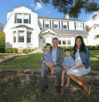 Tony and Ashley Ruggeri pose with their children Juliana and Michael on the front lawn at of their home at 6935 Lakeshore in Dallas.(Louis DeLuca/Staff Photographer)