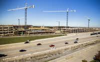 Construction crews work on Plano's Legacy West mixed-use development at the northwest corner of Legacy Drive and the Dallas North Tollway in 2015.((Ashley Landis/The Dallas Morning News))