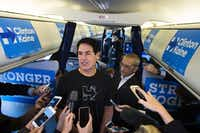 Businessman and investor Mark Cuban spoke to reporters on Democratic presidential nominee Hillary Clinton's campaign plane while flying to Detroit on Friday. (Brendan Smialowski/Agence France-Presse)