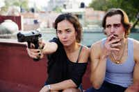 Alice Braga as Teresa Mendoza and Jon Ecker as Guero in <i>Queen of the South</i>. (Benedicte Desrus/USA Network)