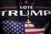 Minister E.J. Christian, 68, wears a Donald J. Trump themed shirt with a cross necklace before the Republican Presidential nominee holds an event at the Eisenhower Hotel and Conference Center October 22, 2016 in Gettysburg, Pennsylvania.  Trump delivered a policy speech announcing his plans for his first 100 days in office.(Mark Makela/Getty Images)