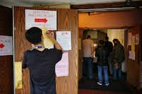 "<p><span style=""font-size: 1em; background-color: transparent;"">Elias Luevano, a student volunteer from Skyline High School, fills out paperwork as people wait in line to vote at Vickery Baptist Church Tuesday, November 8, 2016 in northeast Dallas. Voters across the country will decide the outcome of the presidential election, as well as various statewide and local races and measures.</span></p>(G.J. McCarthy/Staff Photographer)"