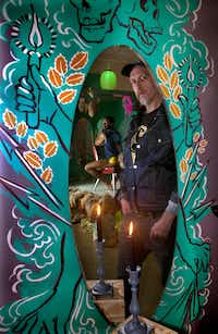 """Artist Heyd Fontenot (front) at his performance art exhibition, """"Kult Klassic."""" Actor Corey Murray is seen reflected. (Nan Coulter/Special Contributor)"""