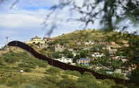The state of Sonora on the Mexico side of the border is seen across the border wall from Nogales, Arizona. (AFP/Getty Images)