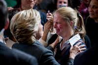 Democratic presidential candidate Hillary Clinton consoled a supporter after speaking at the New Yorker Hotel in New York on Wednesday morning, when she conceded her defeat to Republican Donald Trump after the hard-fought presidential election. (Andrew Harnik/The Associated Press)