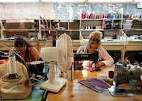 Using vintage Singer sewing machines, workers stitch patterns on boot leather at M.L. Leddy's in San Angelo. (Helen Anders)