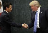 Mexican President Enrique Pena Nieto and U.S. president-elect Donald Trump shook hands after a meeting in Mexico City this summer. (2016 File Photo/AFP/Getty Images)