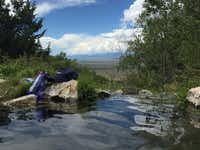 The view of the Waterfall Pond at Valley View Hot Springs.(Sophia Dembling)