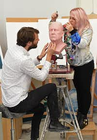 Principal Sculptor David Gardner, left, and Sophie Crudgington work on an an unfinished wax figure of President-elect Donald Trump, which will be released in January, at the Madame Tussauds studio in west London, Wednesday, Nov. 9, 2016. (Charlotte Ball/PA via AP)(Charlotte Ball/AP)