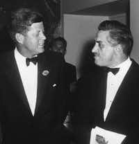 "Merriman Smith and President John Kennedy at a 1962 White House Correspondents association dinner. <p><span style=""font-size: 1em; background-color: transparent;"">(White House photo by Abbie Rowe, collection of John F. Kennedy Presidential Library and Museum.)</span><br></p><p></p>"