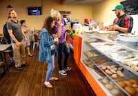 Friends Evan Gordon (center, right) and Zoe Pesce of Dallas pick out pastries.(Tom Fox/ The Dallas Morning News)