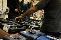 "Contrary to what you may have heard, there is no such thing as a ""gun-show loophole"" to firearms regulations. The only exception to federal background checks is sale or transfer between same-state private individuals, as opposed to gun dealers, wherever that sale or transfer happens. (Spencer Platt/Getty Images)"