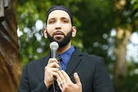 Imam Omar Suleiman of the Yaqeen Institute for Islamic Research in Irving spoke during a Dallas/Fort Worth chapter of the Council on American-Islamic Relations candlelight vigil after the Charleston, S.C., church murders in 2015. ((Nathan Hunsinger/The Dallas Morning News))