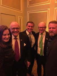 Judith and former New York Mayor Rudy Giuliani, from left, Genesco CEO John Tatum, New York Jets owner, Woody Johnson, and Mark  Oz  Geist,  Marine Corps. veteran and survivor of the Battle of Benghazi, celebrate Donald Trump's victory on election night at the New York Hilton.(Genesco Sports)