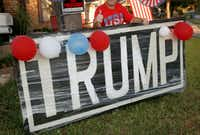 "Jerry Tarter gives a thumbs up as he poses behind a big Donald Trump sign he made with plywood and put in his front yard in Garland a couple weeks before the election.&nbsp;(<p><span style=""font-size: 1em; background-color: transparent;"">Guy Reynolds/Staff photographer</span></p>)"