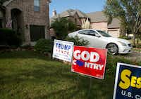 Riner pulls out of her drive past political signs supporting Donald Trump and Pete Sessions as she leaves her home office to go show a property to a potential tenant in Sachse, Texas.(Guy Reynolds/Staff photographer)