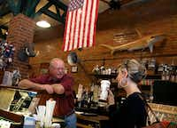 "Kent Crane, owner of Shoemaker & Hardt Coffee House and Country Store, and a Donald Trump voter, speaks with Missy Hefty, of Prosper, Texas, about the quality of the Chai tea latte they serve, Friday, Nov. 11, 2016 in Wylie, Texas. Hefty, a Wylie ISD employee on lunch break, said she loves their tea and always gets a ""ginormous"" size to go. Hefty said she voted for Gary Johnson. (Guy Reynolds/Staff Photographer)"
