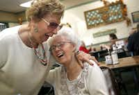 Carol Wood (right), owner of Joe's Coffee Shop, receives a hearty hug from longtime friend Jolene Lear at Joe's Coffee Shop Nov. 10, 2016 in Irving, Texas.(Guy Reynolds/Staff Photographer)