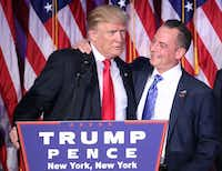 """President-elect Donald Trump and Reince Priebus, chairman of the Republican National Committee, embrace during his election night event at the New York Hilton Midtown in the early morning hours of Nov. 9.&nbsp;(<p><span style=""""font-size: 1em; background-color: transparent;"""">Mark Wilson/Getty Images</span><br></p><p></p>)"""
