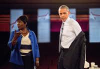 President Barack Obama removed his coat as he prepared to participate in a televised town hall event in Elkhart, Ind., in June with moderator Gwen Ifill. (Pablo Martinez Monsivais/The Associated Press)
