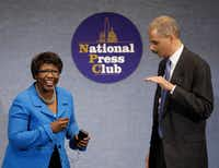 Then-Attorney General Eric Holder shared a moment with Gwen Ifill during an NAACP Legal Defense and Educational Fund luncheon at the National Press Club in Washington, D.C., in May 2009. (File Photo/The Associated Press)