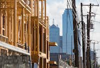 The Broadstone Trinity Grove apartments, left, under construction on Tuesday, October 12, 2016 at 305 W. Commerce St. in Dallas. (Ashley Landis/The Dallas Morning News)(Staff Photographer)