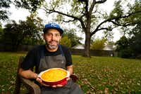 For Thanksgiving, pitmaster Matt Dallman of 18th & Vine sets up tables under his old cottonwood tree in the backyard of his Dallas home. (Tom Fox/Staff Photographer)