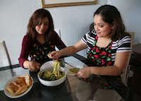 Carolina Maldonado (right), pitmaster at Lockhart Smokehouse, eats Poblano Pepper Spaghetti with her aunt Rosa Maldonado at her aunt's home in Dallas.(Rose Baca/Staff Photographer)