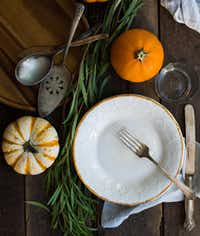 Let your tabletop be a mix of old and new, expensive and inexpensive.Rebecca White
