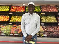 Joseph Kemp stands in front of produce at his new Save-A-Lot store at 3450 Simpson Stuart Road. The store received financial subsidies from the city of Dallas.