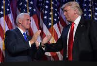 Donald Trump and his running mate Mike Pence celebrate on election night at the New York Hilton Midtown in New York.((MANDEL NGAN/AFP/Getty Images))