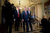 Senate Majority Leader Mitch McConnell of Ky., center, accompanied by Sen. John Barrasso, R-Wyo., left, and Senate Majority Whip Sen. John Cornyn of Texas in Washington, Wednesday, Nov. 16, 2016. (AP Photo/Andrew Harnik)(AP)