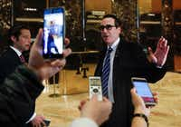 Steven Mnuchin, national finance chairman of President-elect Donald Trump's campaign, waves after speaking to media at Trump Tower on Wednesday.AP/Carolyn Kaster