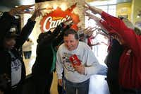 Tom Blight, of Euless, Texas is the first customer of the day during the grand opening of a Raising Cane's in Dallas on Tuesday, February 16, 2016. Blight arrived at the restaurant just before 1pm the previous day to be the first customer of 20 in line to receive a box combo every week for a year. (Vernon Bryant/The Dallas Morning News)(Staff Photographer)