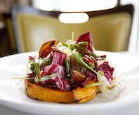 Pumpkin Salad with Medjool Dates and Pecans at LARK on the Park in Dallas.(Nathan Hunsinger/Staff Photographer)