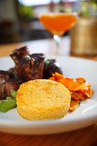 Pumpkin Polenta with Osso Bucco served at Mudhen Meat and Greens.(Tom Fox/Staff Photographer)