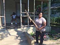 Netra Reese, shown in June, keeps this stick by the porch of her Dallas home for protection from the large aggressive dogs who lived across the street and frequently escaped from the backyard to terrorize her and her neighbors. (Naomi Martin/Staff)