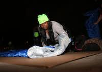 Kimberly Jenkins lays out her sleeping bag during the Promise House Sleep Out. (Rose Baca/Staff Photographer)