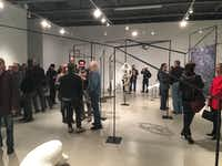 "Opening night of France Bagley's ""The Lay of the Land"" at Kirk Hopper gallery. (Rick Brettell/The Dallas Morning News)"