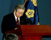 In this Dec. 11, 1997 file photo, South Korean President Kim Young-sam bows to the nation before he reads a speech apologizing for the country's economic crisis at the presidential palace in Seoul. (Yonhap via AP, File)(AP)