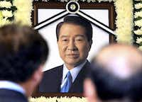 A portrait of the late former South Korean President Kim Dae-jung is seen as mourners visit the memorial room at a hospital in Seoul, South Korea, Tuesday, Aug. 18, 2009. (AP Photo/Yonhap, Chou Jae-koo)(AP)