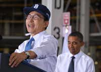 South Korea's President Lee Myung-Bak speaks as  US President Barack Obama looks on following a tour of the General Motors Orion Assembly plant October 14, 2011 in Lake Orion, Michigan.(AFP/Getty Images)