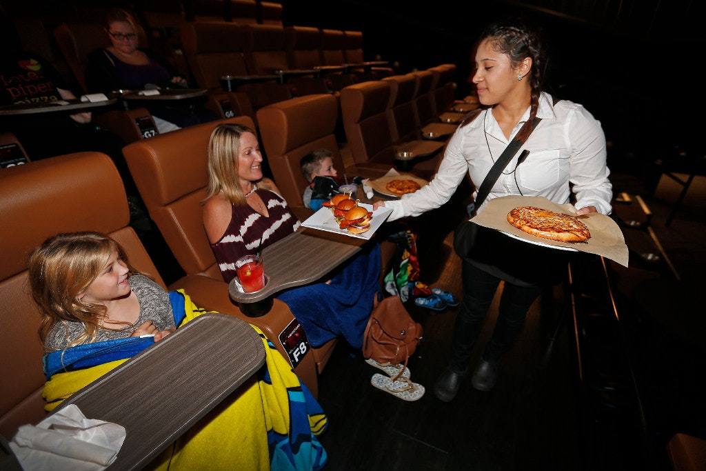 Waitress Mary Gomez (right) Serves The Food For Larissa Boyd (second From  Left) At Studio Movie Grill In The Colony. Boyd Came To The SMG With Her  Son Blake ...