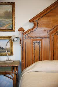 An antique bed sits in the guest room of Richard Theiss. (Andy Jacobsohn/Staff Photographer)