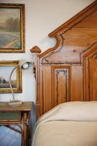 An antique bed sits in the guest room of Richard Theiss. Andy Jacobsohn/Staff Photographer